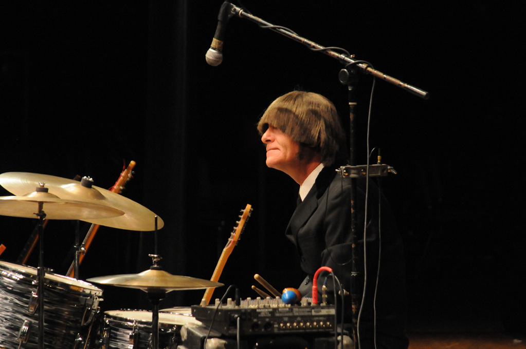 Ringo (Gerard Barberine Jr.) plays the drums during the fundraising 