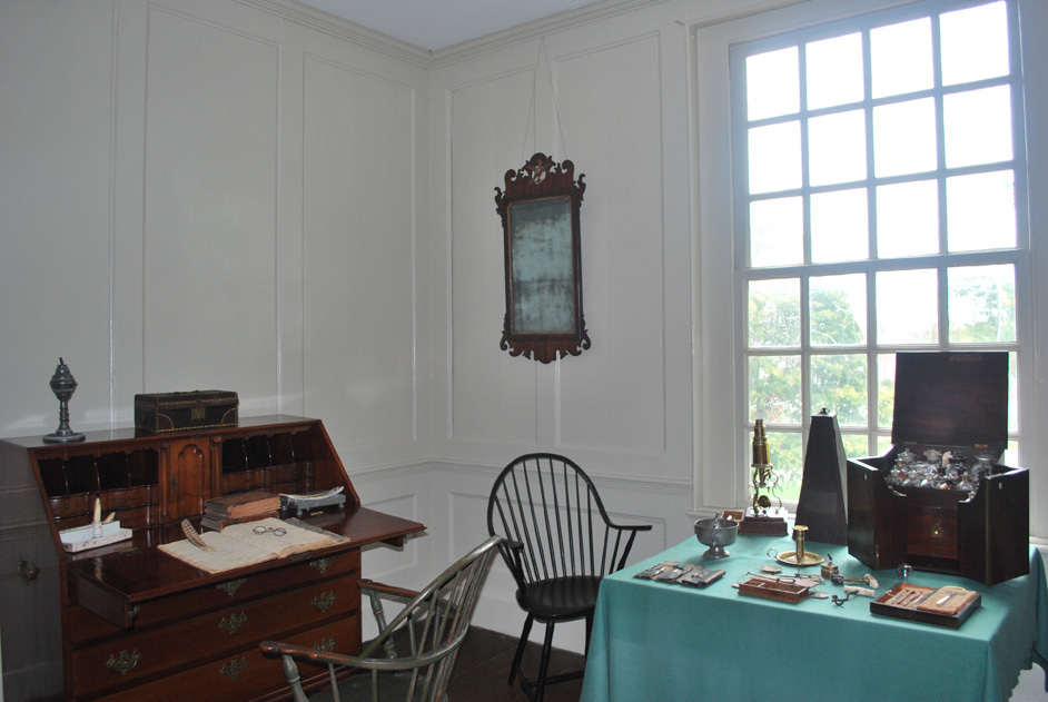 Dr. Samuel Martin's study, with a microscope on the table by the window.