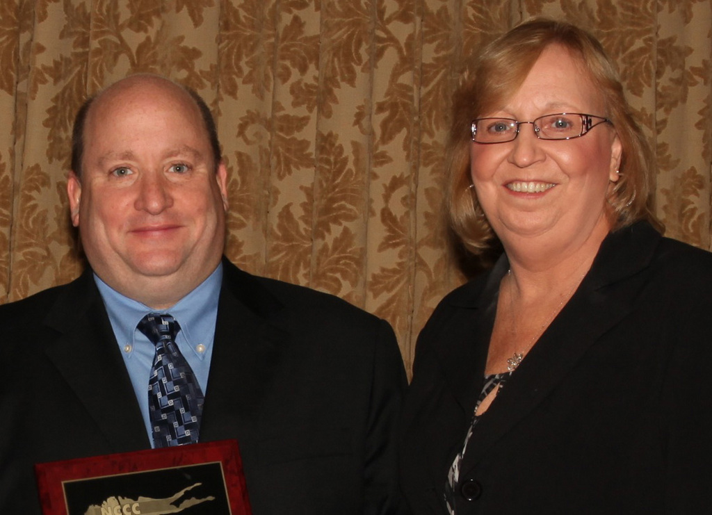 Charles Lunenfeld was congratulated by East Rockaway Chamber President Debbie Hirschberg.