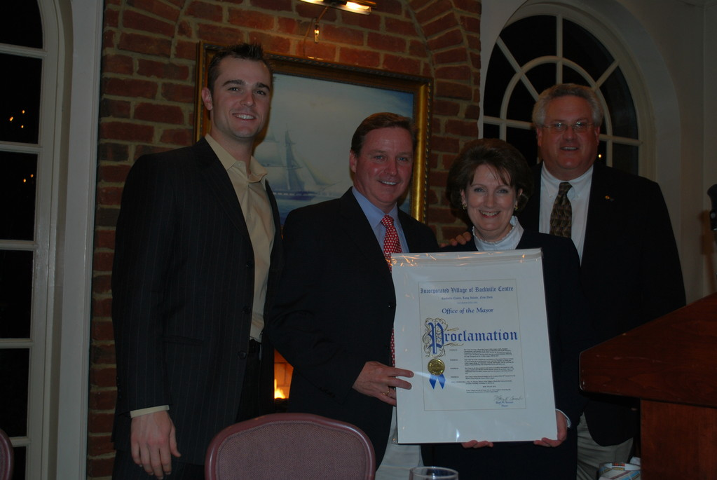 Mayor Mary Bossart presented a proclamation to Bob Tolan, to her right, who will step down from his post as Little League president next year. Tom Bucaria, far right, will become the new president once Tolan leaves. With them is the featured speaker at the annual event, Yankee David Robertson.