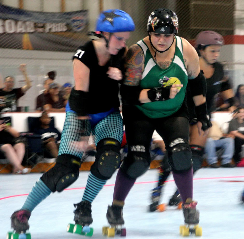 "The club's president, Lauren Madonia, a.k.a. ""Captain Morgan,"" right, is a Lynbrook resident and founding member of the L.I. Roller Rebels."