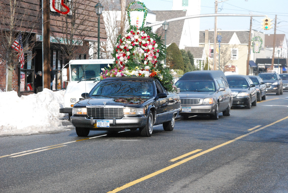 A funeral procession down Long Beach Road in Island Park followed the services at Sacred Heart on Dec. 31, which Representative Peter King and Bishop William Murphy attended, among others.