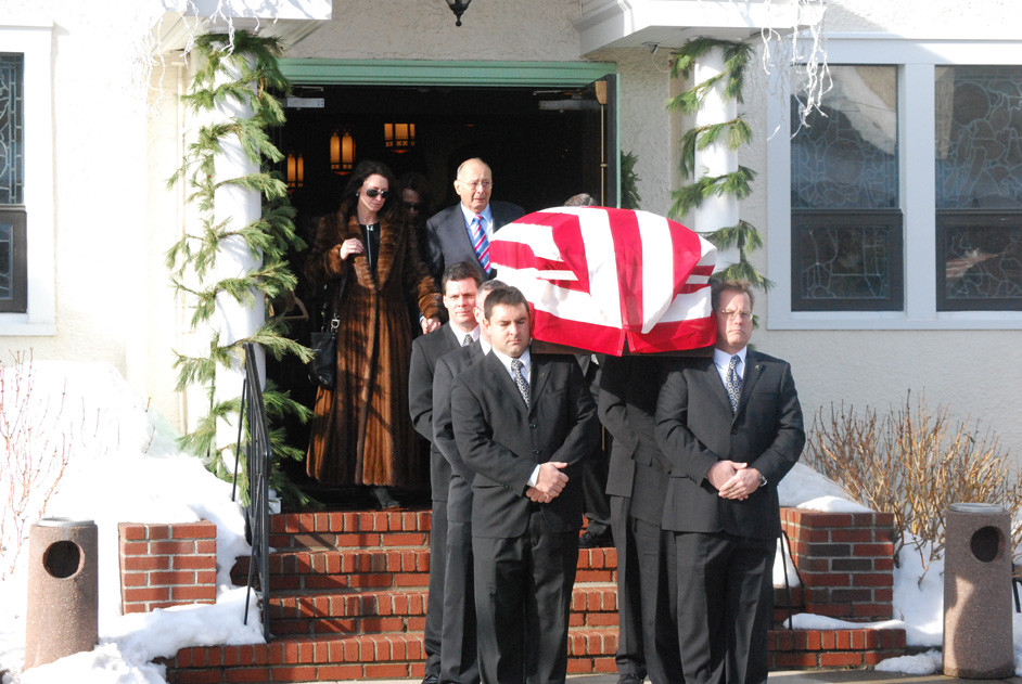 Alfonse D'Amato, center, with his wife, Katuria, followed his father's casket out of the Sacred Heart Church in Island Park on Dec. 31.