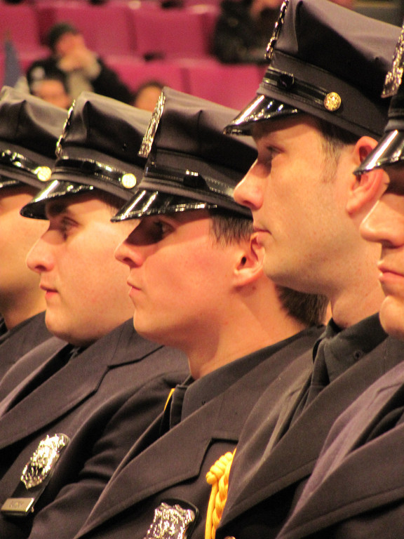 Conor McDonald, center, was among 1,150 new NYPD graduates.