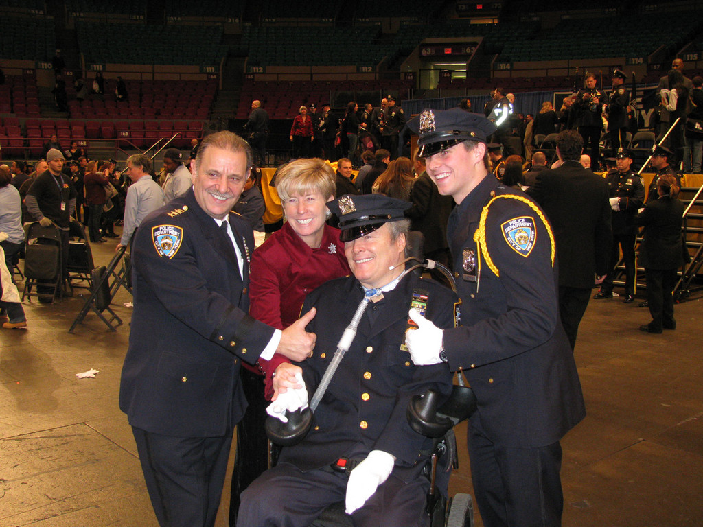 Conor McDonald posed after graduation his father, NYPD hero Det. Steven McDonald, mother, Malverne Mayor Patricia McDonald, and NYPD officials.