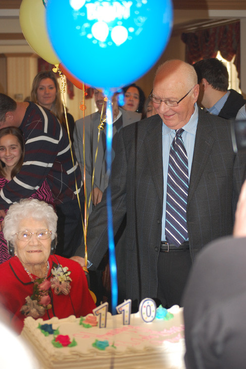 Marietta Capizzi is joined by her son, Peter, at her 110th birthday party.