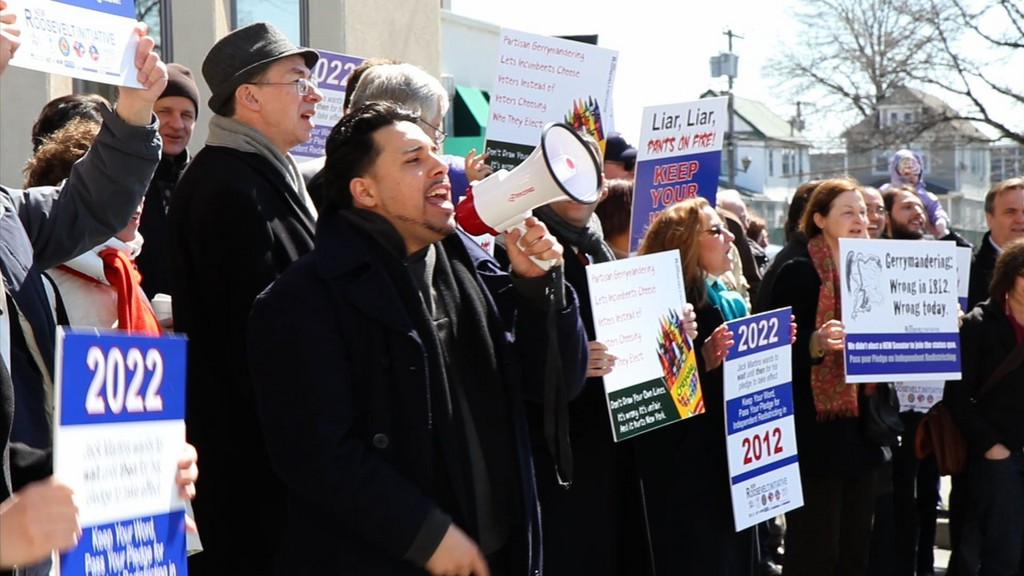 Nearly 60 protesters gathered outside of Sen. Jack Martins' office on March 29.