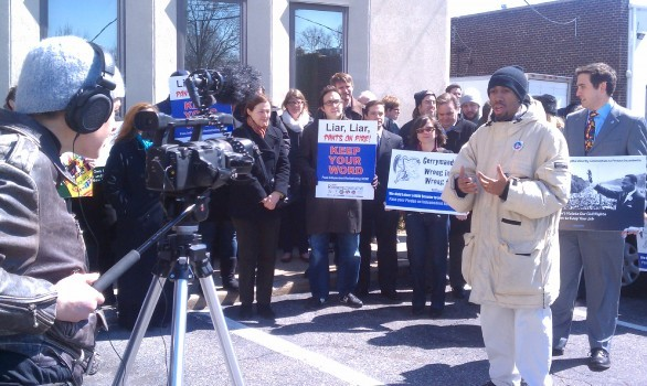 Kyle Strober, vice president of Nassau County Young Democrats, speaks in front of a news camera at the March 29 rally.