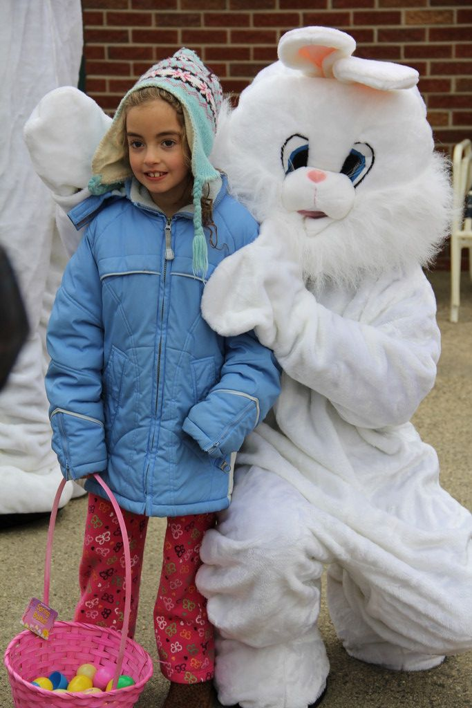 Sara Schaefer, 8, after gathering numerous eggs, took a moment to greet the Easter bunny.