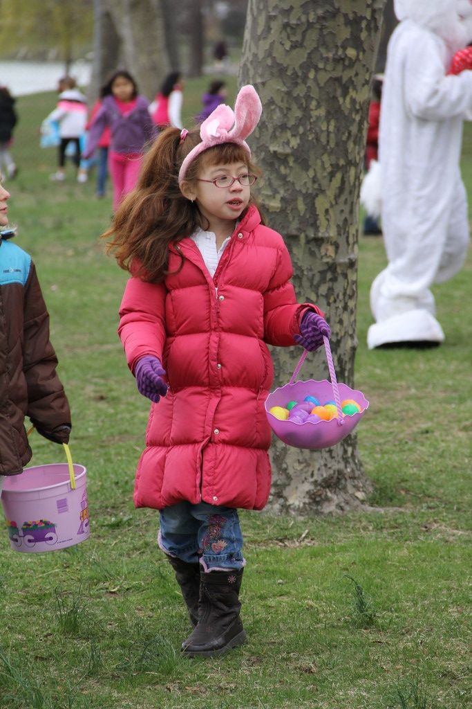 Kayle Picillo hunts for more treasure at the village's annual Easter egg hunt.