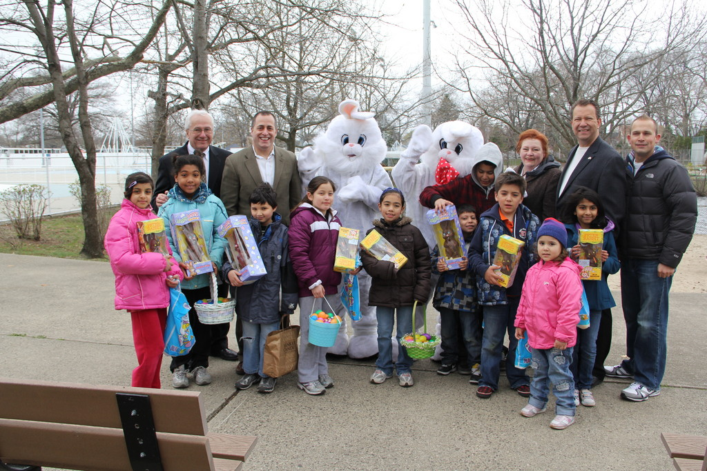 The finders of the gold and silver Easter eggs with their prizes, giants chocolate bunnies, are joined by local officials.