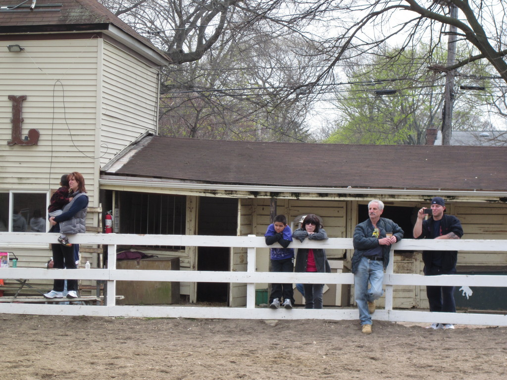 Equestrians watched quietly as the main barn came down.