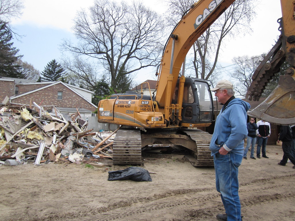Bob Douglas, 74, examined the debris of what was once the clubhouse. He has been a regular at the facility for 52 years.