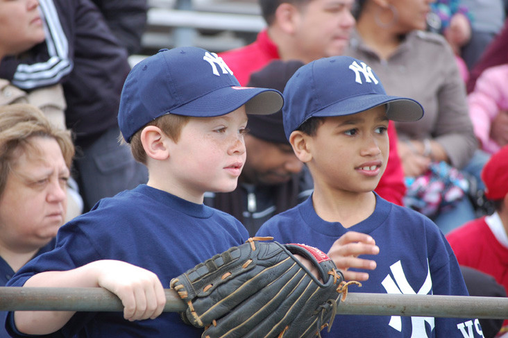 Baseball Leaguers Conner Gale, left, and Miles Morgan watch the Opening Day ceremonies at Firemen's Field.