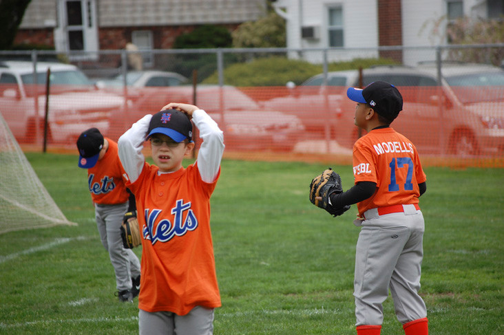 Players on the Mets warm up for their first game of the season.