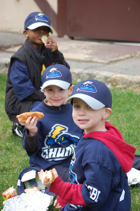 Justin Billa, 4, Michael Cutrone and James Lockhart, both 5, of the Thunder tee ball team enjoyed their snacks after the Opening Day festivities.