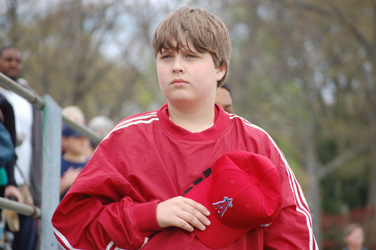 Patrick Loftus, 12, listens to the singing of the National Anthem.