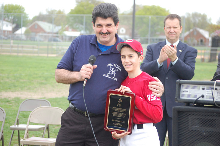 League President Bob Inzerillo presented a belated award to Brian Morales, last year's top player in the Jeter Division.