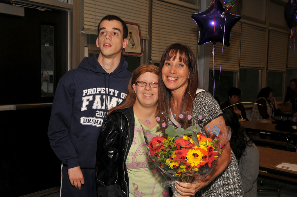 Penny Ellis, celebrated her win at a Best Buddies party with former students Eido Rabinvich, left, and Jessica Portnoy.