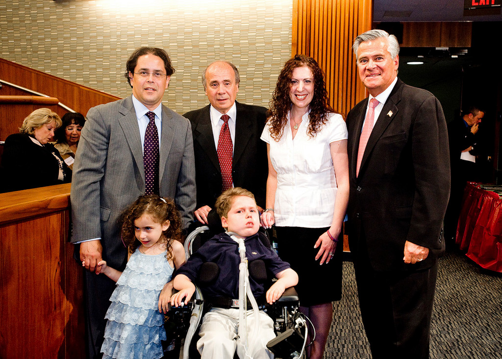 Debbie Cuevas and her family — husband Ron Cuevas, left, father John Martin and children Heather and Dylan, were joined by Sen. Dean Skelos at the recent reception for notable women in the State Capitol building.