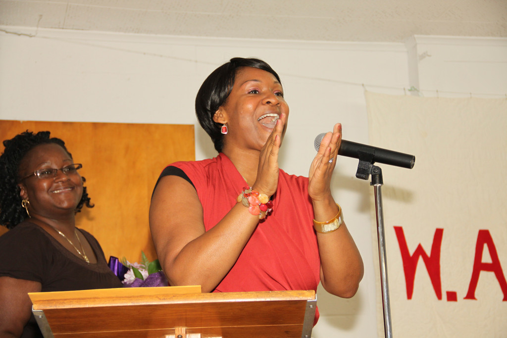 The Rev. Kymberley Clemons Jones congratulates the 13 graduates of the W.A.N.T.E.D. program.