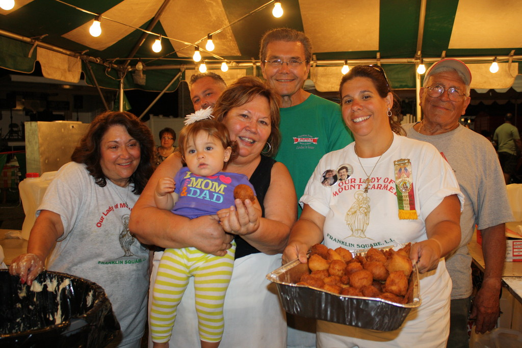 Rosemary Zangla, above, from left, Margaret Gigante, Sienna Gigante Cannon (baby), Gerry Gigante, Michele Proper and Frank Piazza, of the Ladies Auxillary, made sure that all festival-goers had fresh zeppoli.