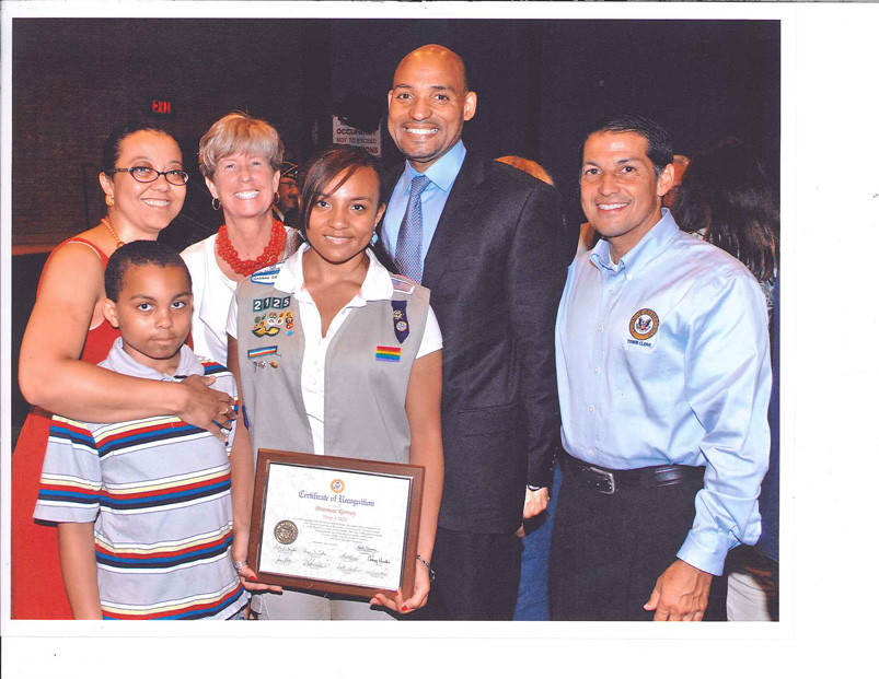 Malvernite Brieonna Ramsey, holding plaque received acertificate of recognition from Hempstead Town Clerk Mark Bonilla for her Gold Award projects. Malverne Mayor Patricia McDonald joined her and her family at the award ceremony.