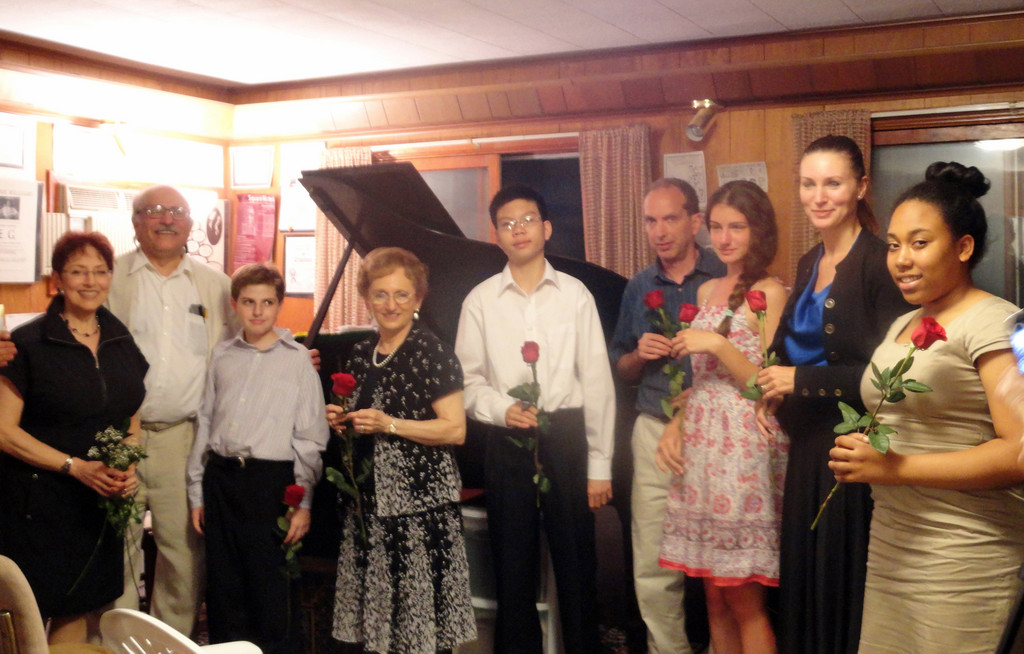 Court Street Music in Valley Stream held a student recital and house concert on June 12.  From left are Helene Williams, Leonard Lehrman, Scott Feiner, Geri Lecessi, Lloyd Tanedo, Tom Smith, Katie Mazalkov, Vera Bloch and Karen Gustave.