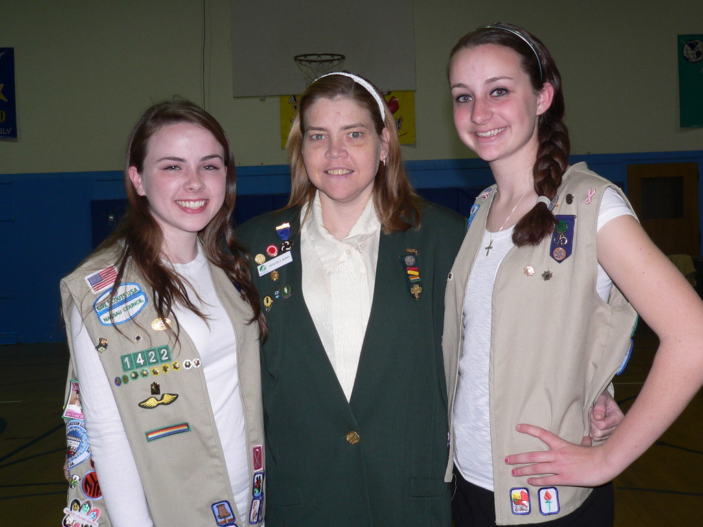 Kiera Grassi, from left, of Troop 1422; Kathleen Murphy, of the Girl Scouts of Nassau