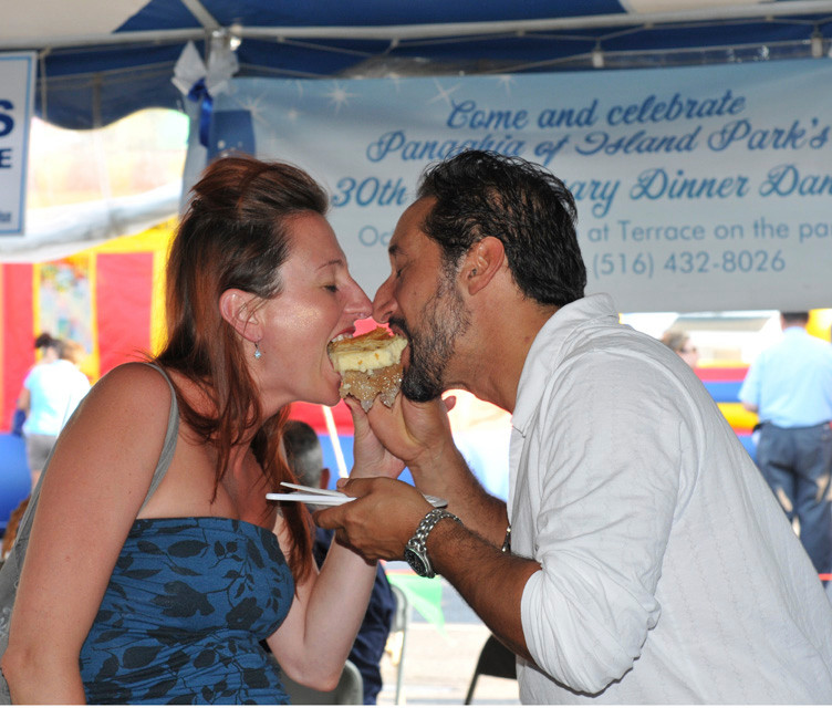 Kimberly and Tommy Decrescenzo from East Rockaway share a pastry at the Greek festival in Island Park.