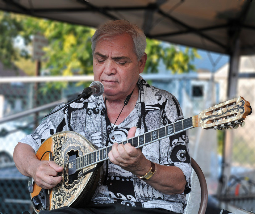Byron Tsiokos entertained the crowd with his bouzouki at the Panaghia Greek Orthodox Church's annual Greek Festival in Island Park last weekend.