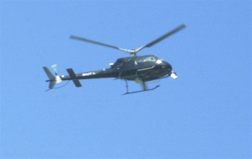 At 10:57 a.m., helicopters were seen circling over the south Merrick area as Nassau County Police pursued one suspect in a North Bellmore home invasion.