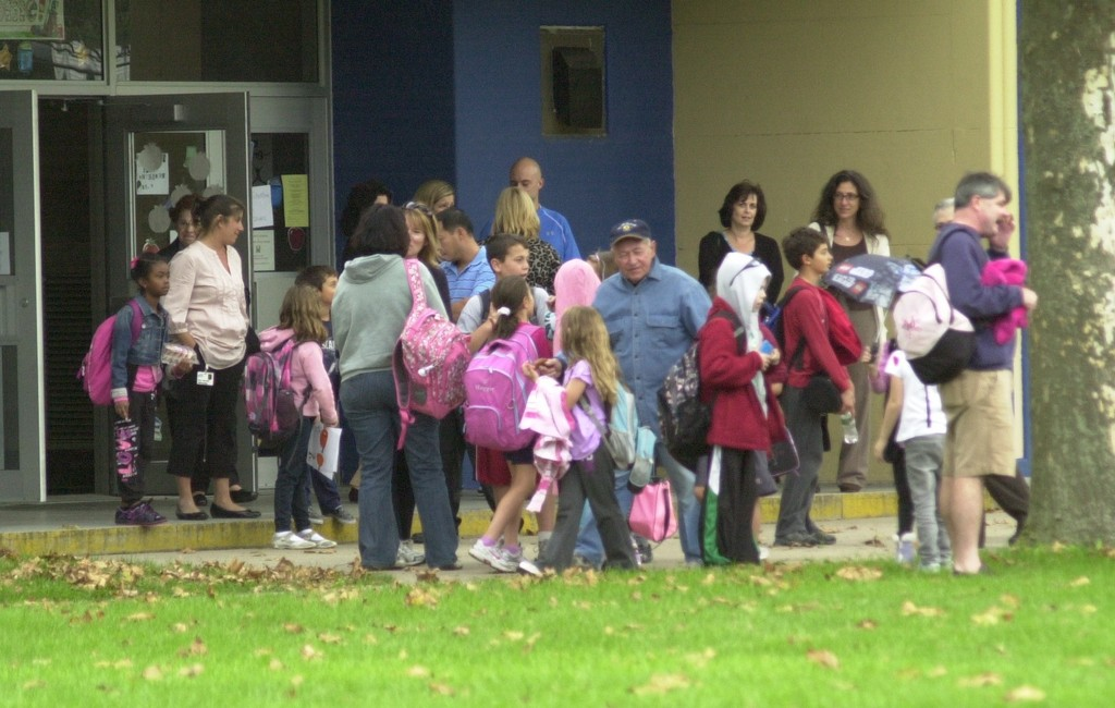 Fayette Elementary School was among three North Merrick area schools that were locked down on Tuesday after police fired shots at a pit bull that mauled a woman. Children were allowed out of the school around 3:45 p.m., but only if a parent or another caregiver was there to escort them home. Police kept a watchful eye on the school from across Merrick Avenue.