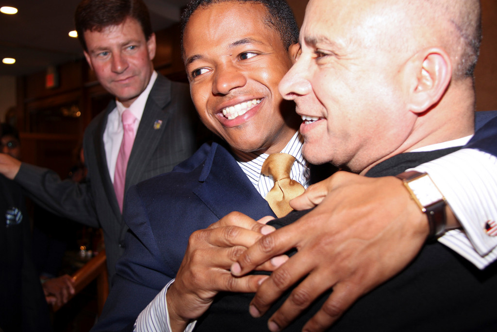 Carrié Solages, center, hugging Ali Mirza, upset eight-term Nassau County Legislator John Ciotti in the 3rd Legislative District on Tuesday.