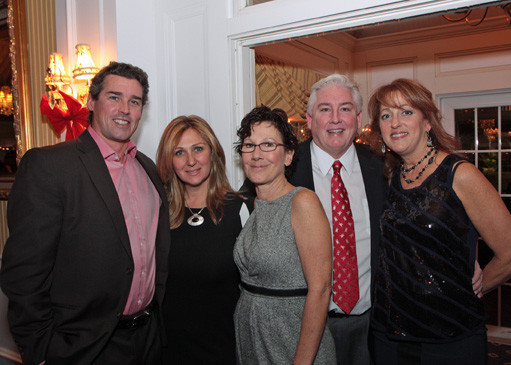 Greg and Johanna Sofield, left, with Cindy Hamlet, Mark McCarthy, owner of Lola's restaurant, and Sue Ehrlich during last year's fundraiser at Bridgeview Yacht Club.