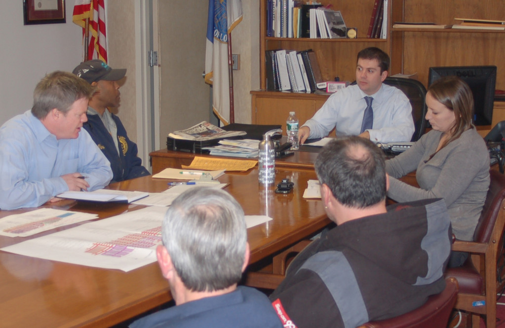 City Manager Jack Schnirman, third from left, met with department heads last week to implement a more efficient snow removal plan.