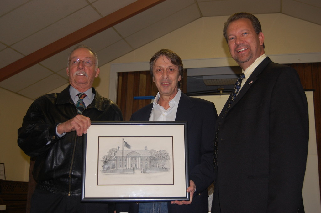 Angelo LaCalandra, center, with Historical Society President Guy Ferrara, left, and Mayor Ed Fare.