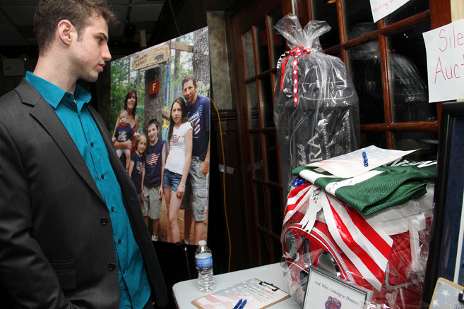 "Jeff DeAnna checked out items in the silent auction at ""Pack the 'Jim' Night,"" held in Franklin Square on Feb. 3."