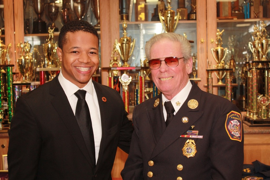 Nassua County Legislator Carrié Solages, left, congratulated Franklin Square-Munson Fire Department past chief Roger Albergo for his 50 years of service to the community.