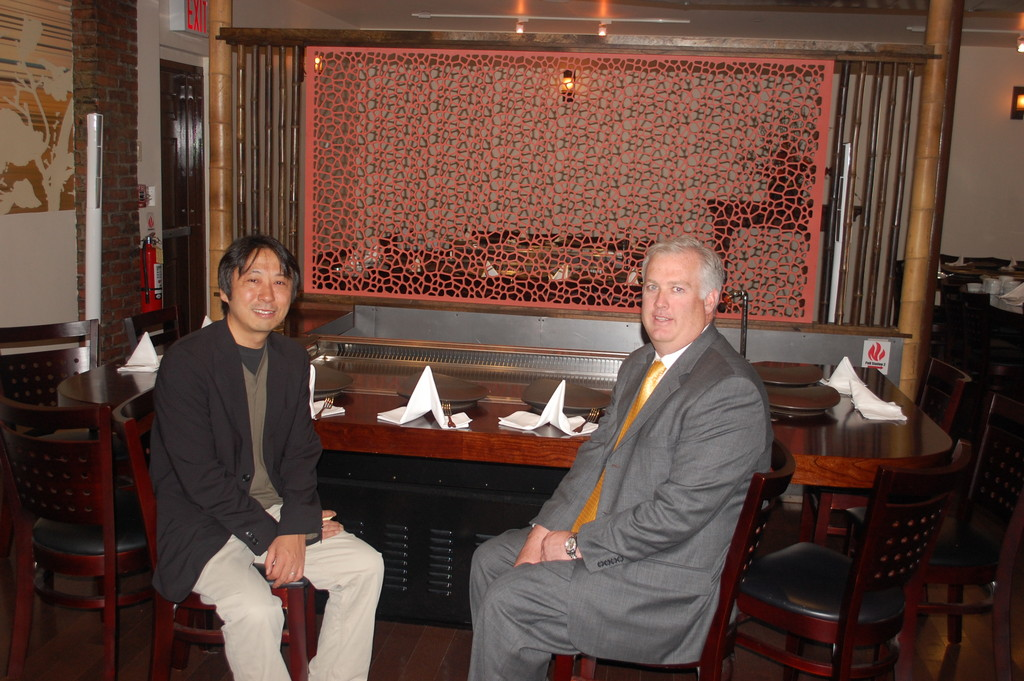 Owner Keiji Inatome, left, and Valley Stream Building Superintendent Thomas McAleer sat at one of the downdraft hibachi grills at the recently reopened Inatome Restaurant.