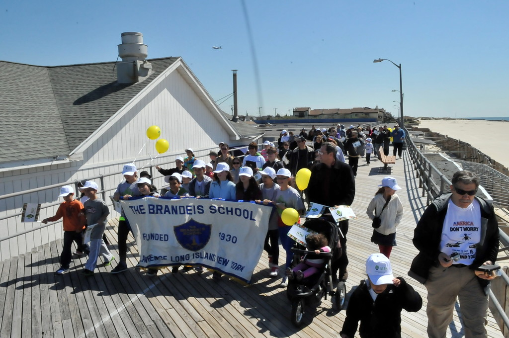 Students, administrators, parents, family and friends walked on the Atlantic Beach last Sunday boardwalk to raise money for ALEH. An Israeli organization that helps severely disabled children.