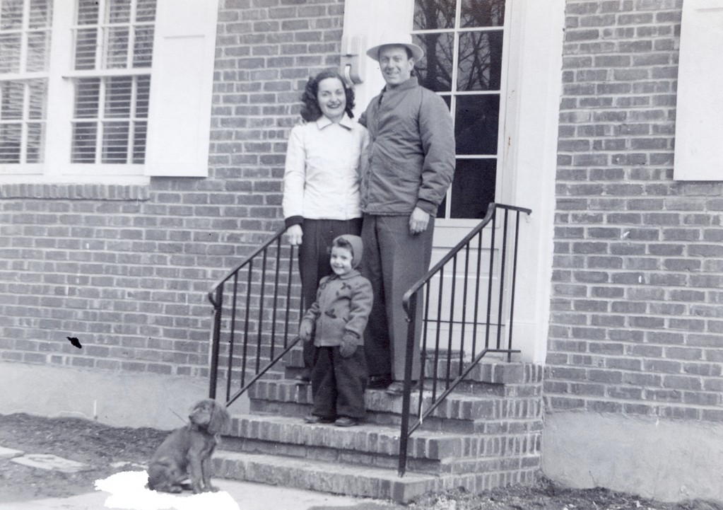 The Sandel family — Lenore, Leonard, their daughter, Susan, and Rusty — in December 1946, in front of the G.I. housing they had just purchased in Rockville Centre.