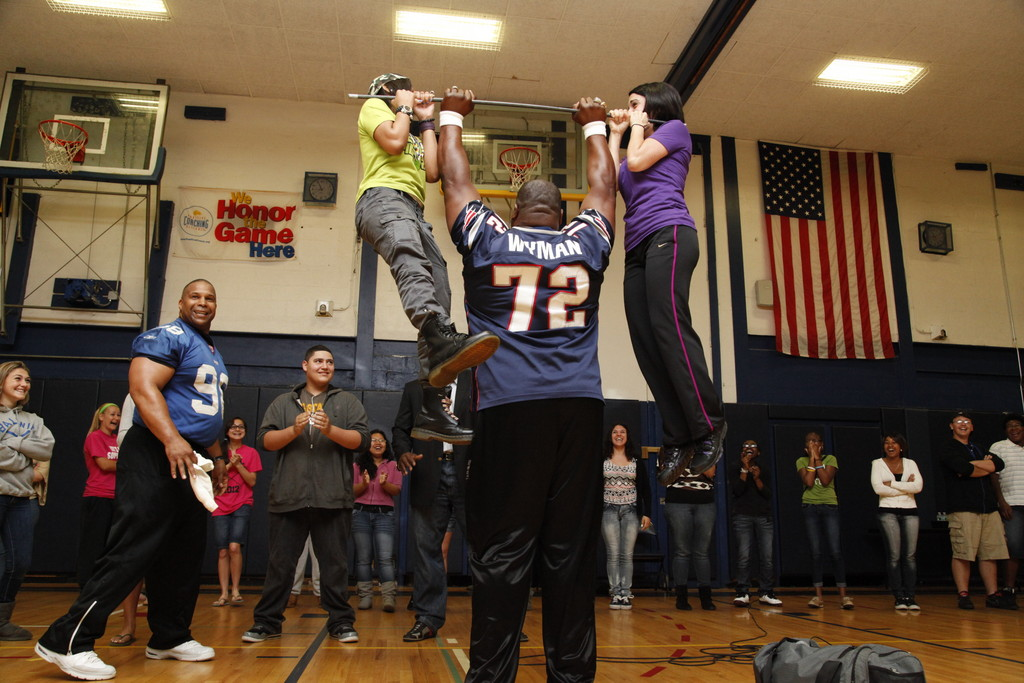 Devin Wyman lifted students Isaihrine Bosse and Christine Ramano while former New York Giant player Keith Davis looked on. The feat was part of a motivational performance the two players staged at BHS.