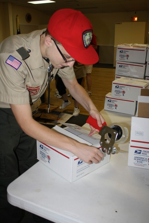 Steven Spohr, 17, finished up packaging the last few boxes to be sent to soldiers overseas.