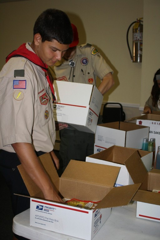 Dominick Brusca helped packed toiletries and magazines for troops in Afghanistan
