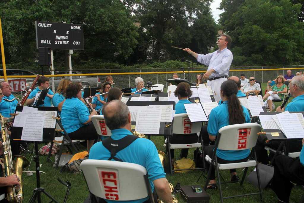 Conductor Eric Albinder led the North Shore Pops Concert Band in a performance at Echo Park baseball field in West Hempstead.