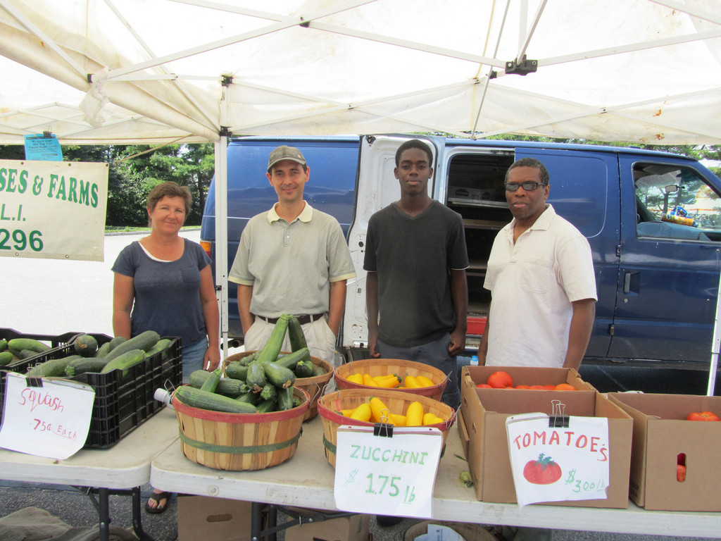 Bernadette Martin, left, Chamber member Muzzio Tallini, Chamber intern Michael Bediako and Chamber member Aubrey Phillips enjoyed the local produce.