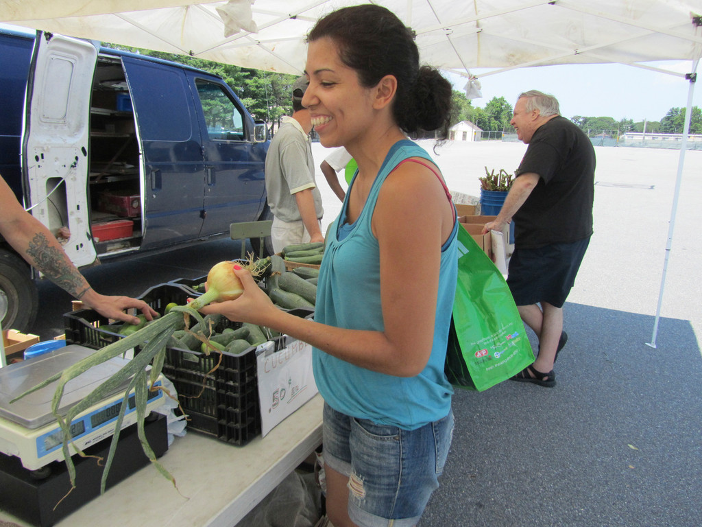 Elmont resident Mayra Piquant is a repeat customer at the Elmont Farmer's market.