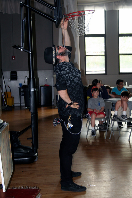 Magician Adam Rinn swallowed several swords at his July 13 performance for Camp Discovery. The longest sword was over two feet long.