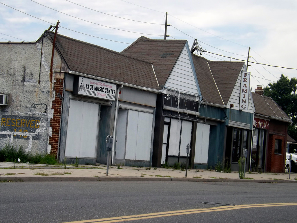 Neighbors have complained to the village on numerous occasions about the condition of vacant buildings on Gibson Boulevard, just south of the train station.